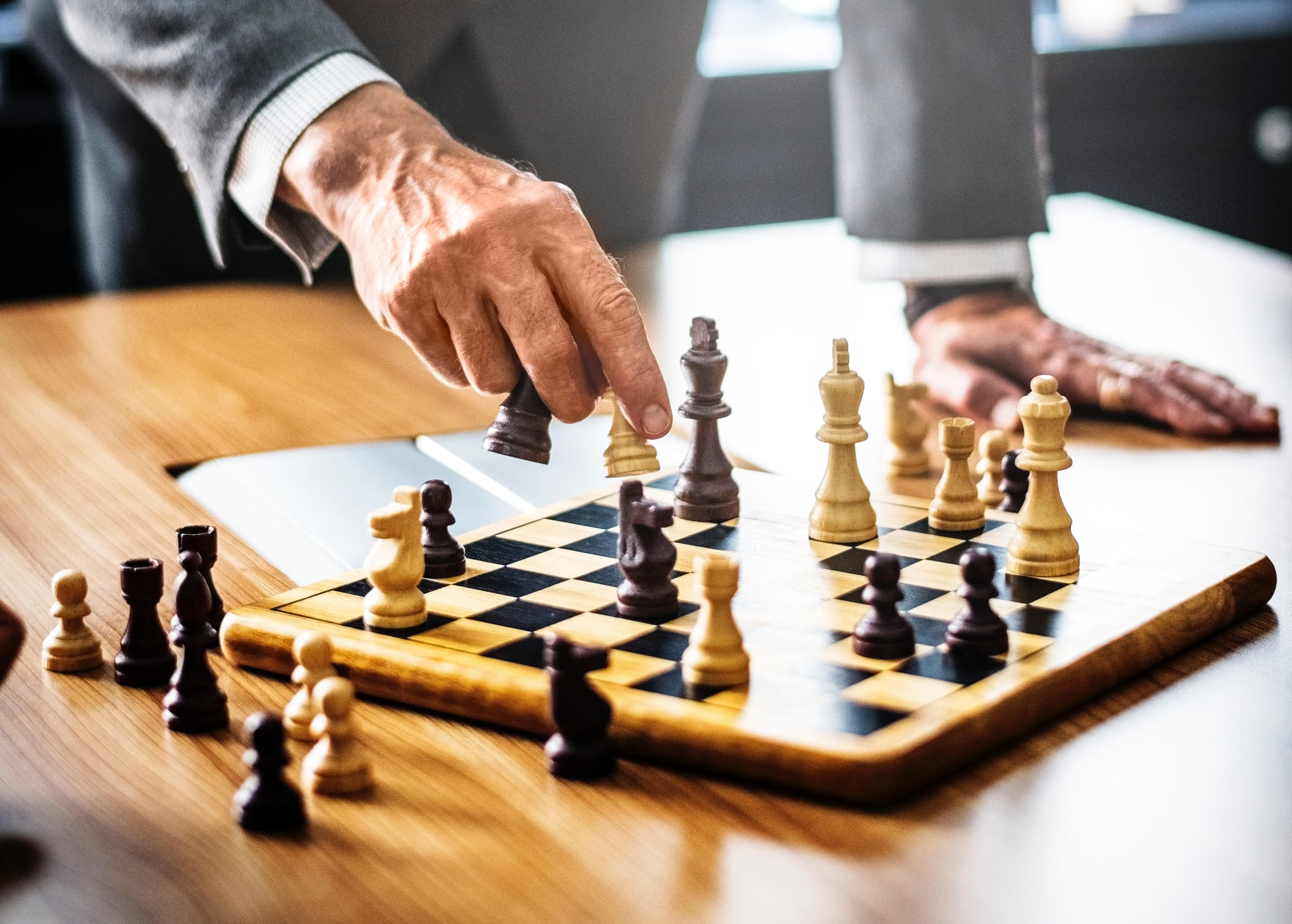 Choosing law firm marketing spend strategy like playing chess
